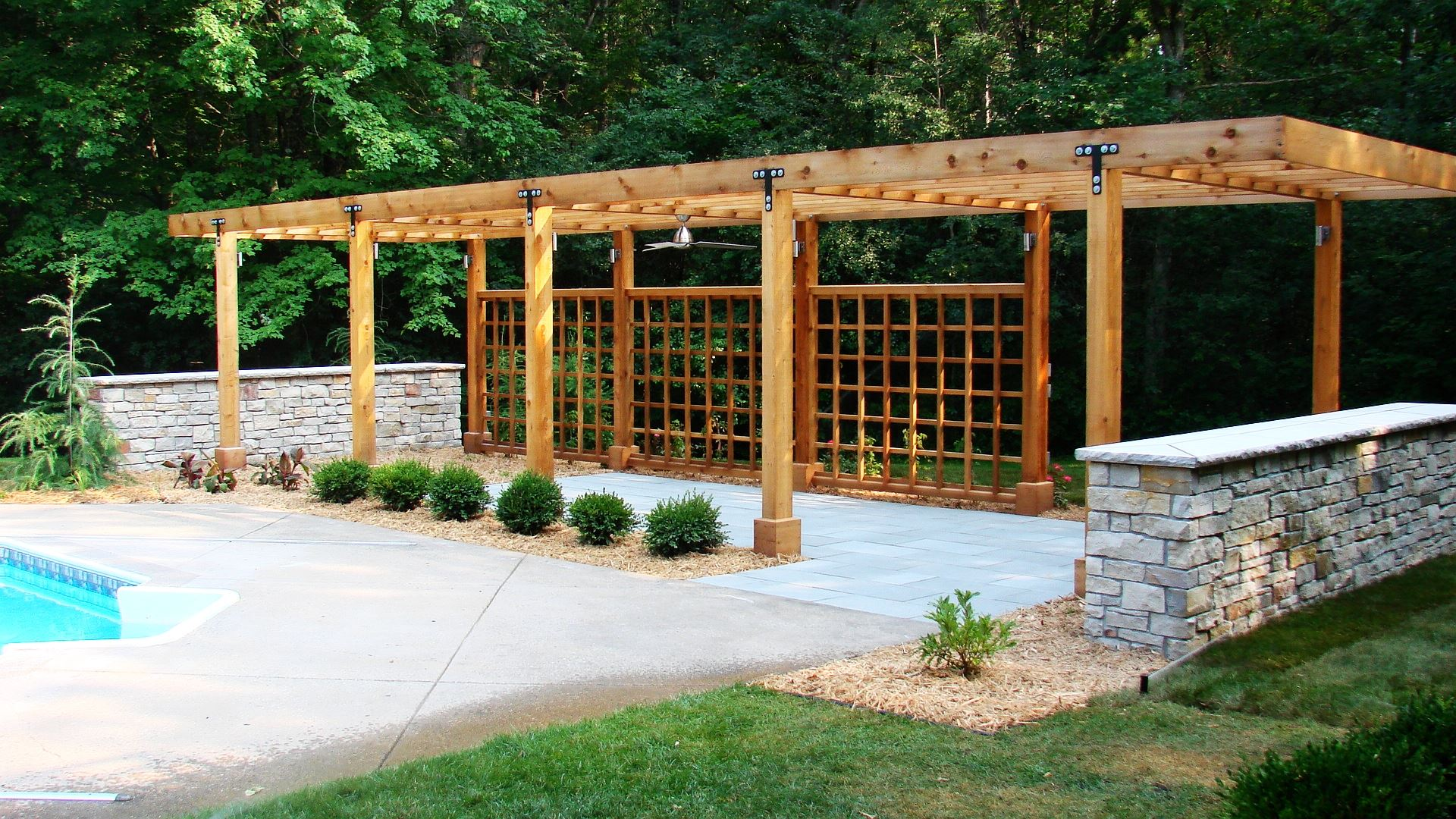 Landscape in Mahtomedi, MN - Pergola and Blue Stone Patio Project in Mahtomedi MN